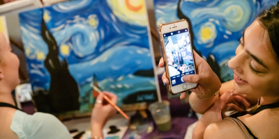 Taking a photo of someone painting Starry Night